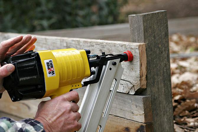 Pneumatic nail gun in use for home repair